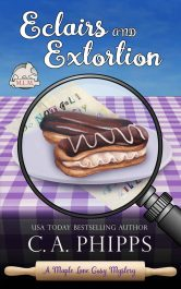 bargain ebooks Eclairs and Extortion Cozy Mystery by C.A. Phipps
